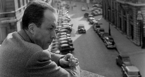 Albert Camus overlooking balcony