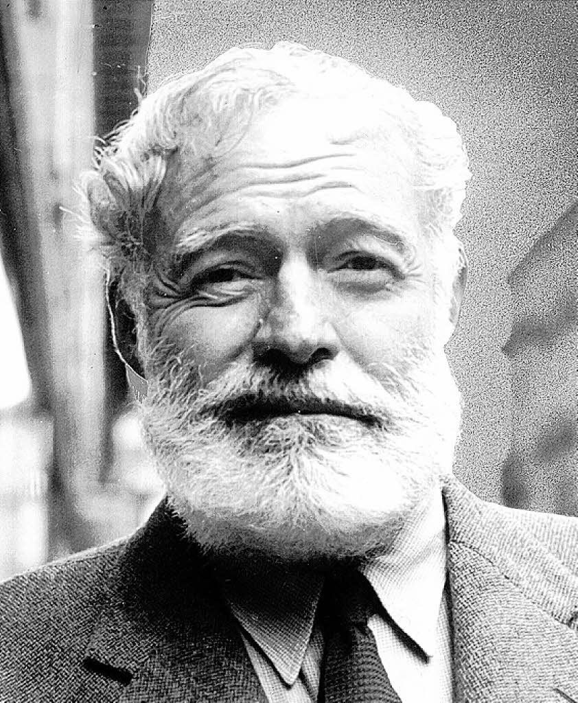 Ernest Hemingway, smirking slightly, almost a sneer