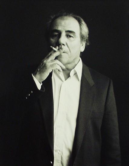 Jean Baudrillard, smoking a cigarette